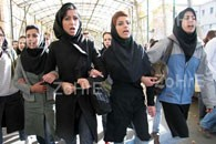 iran-female-students-march.jpg
