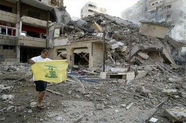 Buildings down, but Hezbollah flag is still up